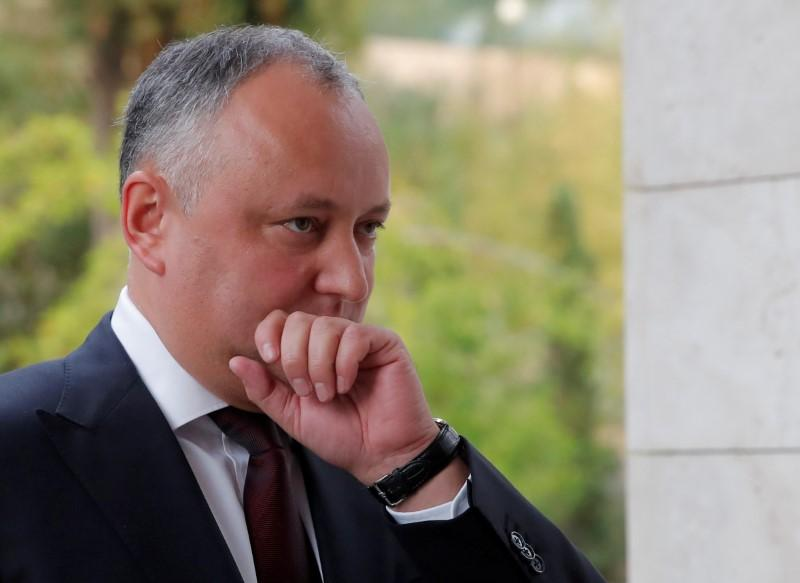 Moldovan leader's powers suspended to enact Russian TV curbs