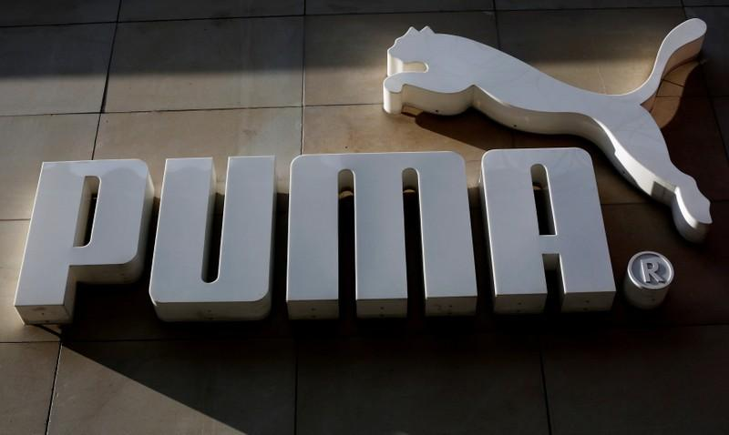 1b8ad1164e7 FILE PHOTO  The logo of German sports goods firm Puma is seen at the  entrance of one of its stores in Vienna
