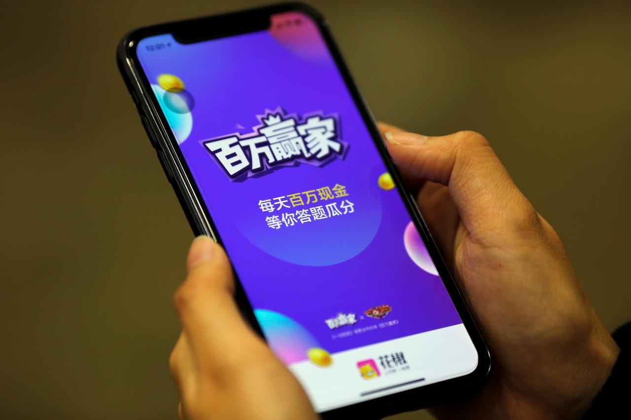 China online quiz craze lures prize seekers, tech giants - Reuters
