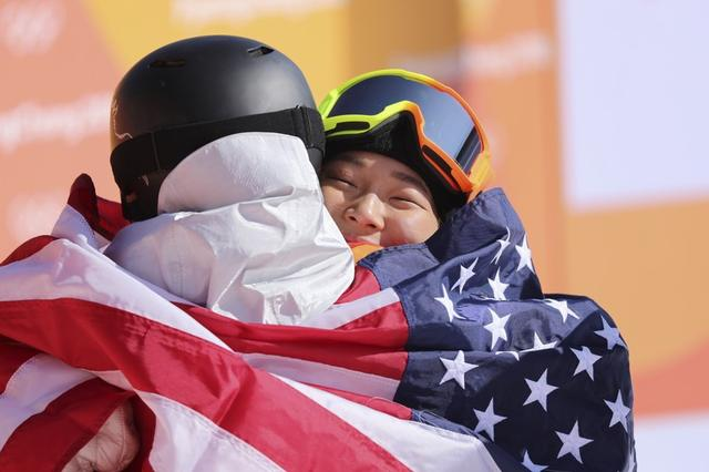 Snowboarding - Pyeongchang 2018 Winter Olympics - Women's Halfpipe Finals - Phoenix Snow Park - Pyeongchang, South Korea - February 13, 2018  - Chloe Kim of the U.S. hugs Arielle Gold of the U.S following her win. REUTERS/Mike Blake