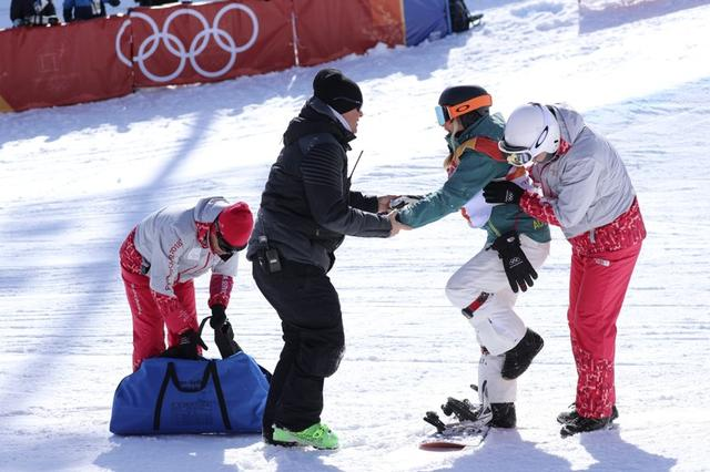 Snowboarding - Pyeongchang 2018 Winter Olympics - Women's Halfpipe Finals - Phoenix Snow Park - Pyeongchang, South Korea - February 13, 2018 - Officials attend to Emily Arthur of Australia after crashing in her final run. REUTERS/Mike Blake