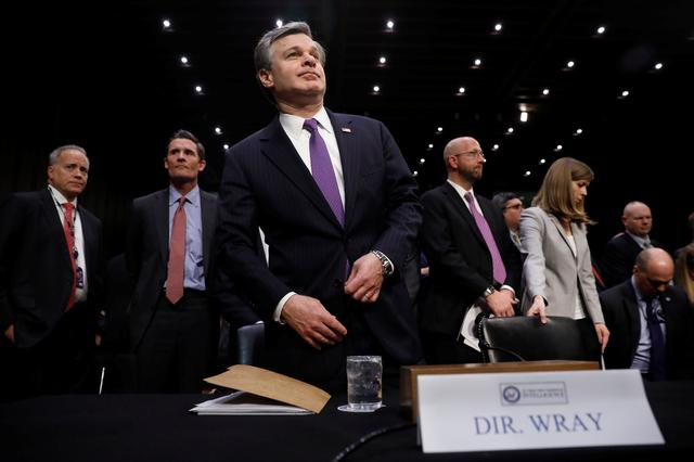 Federal Bureau of Investigation (FBI) Director Christopher Wray arrives to testify before the Senate Intelligence Committee on Capitol Hill in Washington, U.S., February 13, 2018. REUTERS/Aaron P. Bernstein