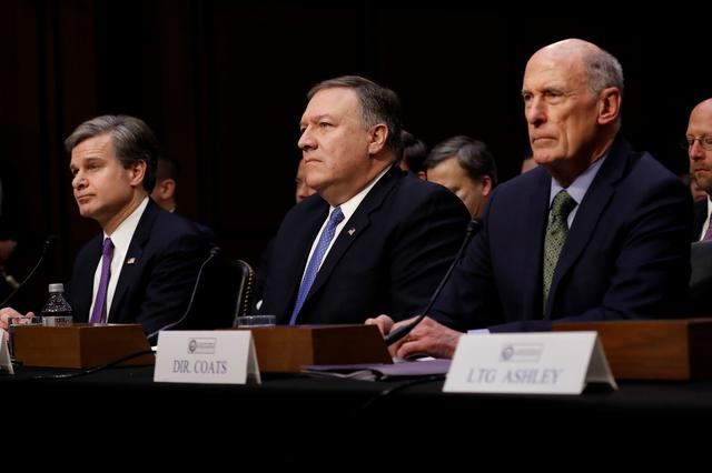 (L-R) Federal Bureau of Investigation (FBI) Director Christopher Wray, Central Intelligence Agency (CIA) Director Mike Pompeo, and Director of National Intelligence (DNI) Dan Coats wait to testify before the Senate Intelligence Committee on Capitol Hill in Washington, U.S., February 13, 2018. REUTERS/Aaron P. Bernstein