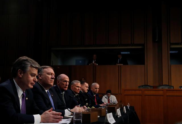 Federal Bureau of Investigation (FBI) Director Christopher Wray, Central Intelligence Agency (CIA) Director Mike Pompeo, Director of National Intelligence (DNI) Dan Coats, Defense Intelligence Agency Director Robert Ashley, National Security Agency (NSA) Director Michael Rogers, and National Geospatial Intelligence Agency Director Robert Cardillo testify during a Senate Intelligence Committee hearing on ''Worldwide Threats'' on Capitol Hill in Washington, U.S., February 13, 2018. REUTERS/Leah Millis