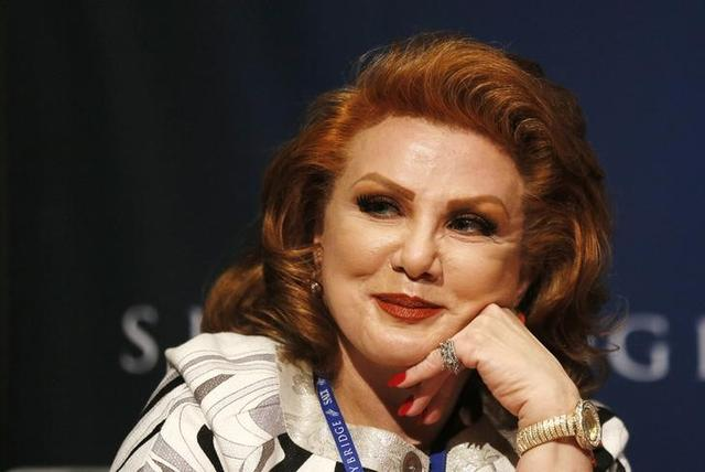 FILE PHOTO: Georgette Mosbacher waits to moderate a panel discussion at the SALT conference in Las Vegas May 15, 2014.   REUTERS/Rick Wilking