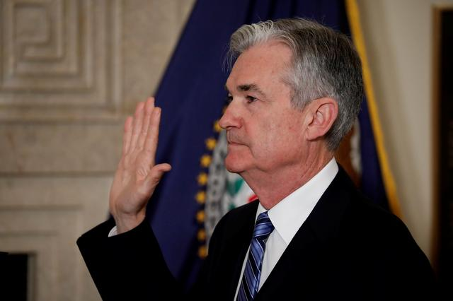 Federal Reserve Chairman Jerome Powell takes the oath of office administered by Federal Reserve Board member Randal Quarles at the Federal Reserve in Washington, U.S., February 5, 2018. REUTERS/Aaron P. Bernstein/File Photo