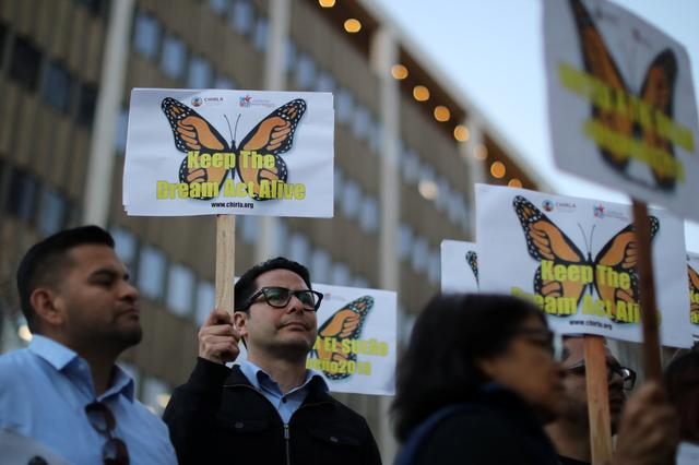 FILE PHOTO -  People protest for immigration reform for DACA recipients and a new Dream Act, in Los Angeles, California, U.S. January 22, 2018. REUTERS/Lucy Nicholson