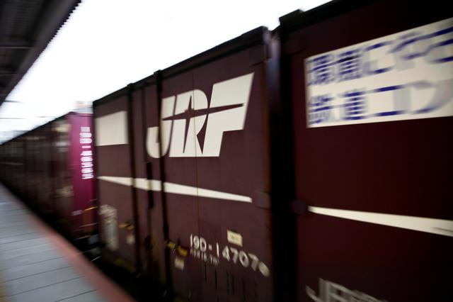 FILE PHOTO: A Japan Rail (JR) freight train passes through a train station in Osaka October 24, 2017.   REUTERS/Thomas White/File Photo