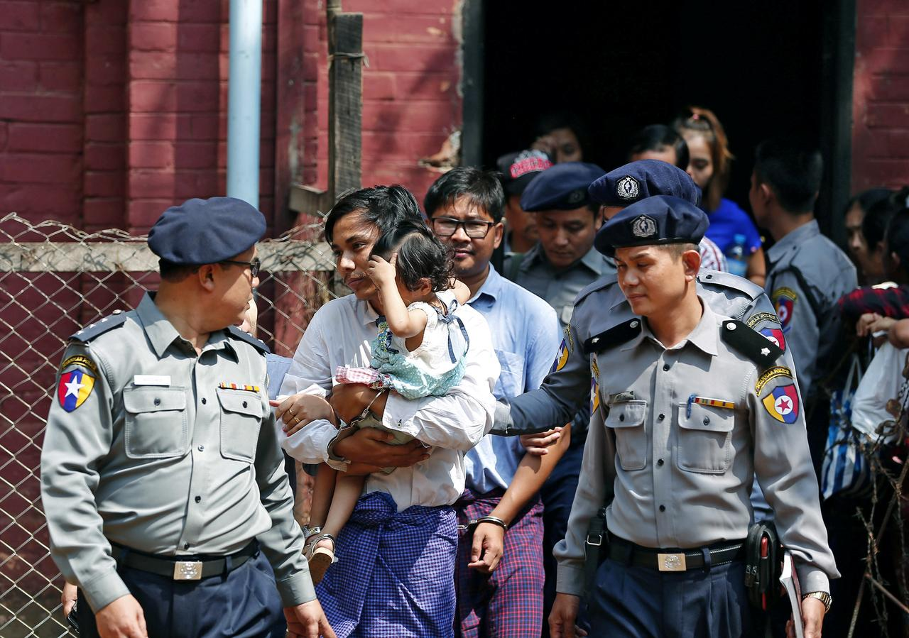 183aac5f4348 Detained Reuters journalist Kyaw Soe Oo and Wa Lone are escorted by police  while arriving for a court hearing after lunch break in Yangon