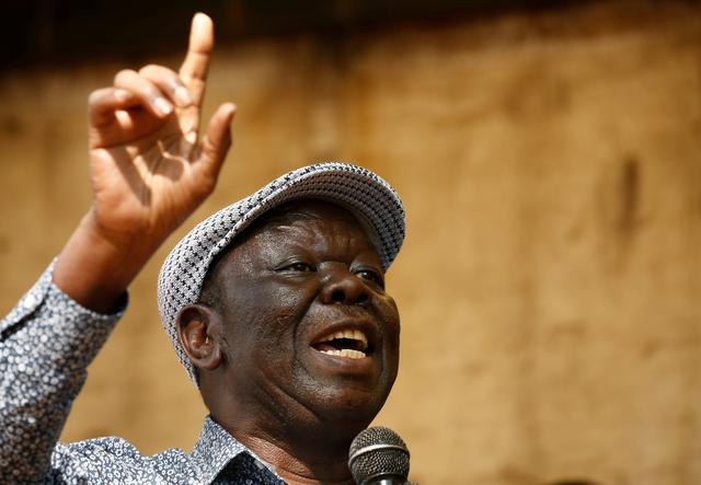 FILE PHOTO: Opposition Movement for Democratic Change leader Morgan Tsvangirai addresses a crowd gathered outside parliament in Harare, Zimbabwe, November 21, 2017. REUTERS/Mike Hutchings/File Photo