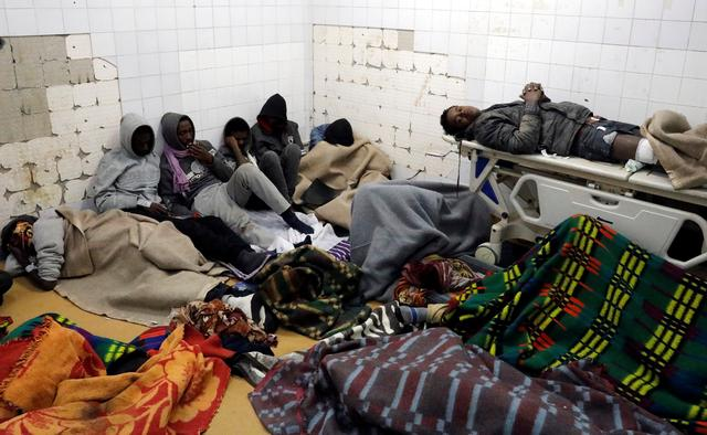 Migrants who were injured in a truck crash, are seen at a hospital in Bani Walid town, Libya, February 14, 2018. REUTERS/Hani Amara