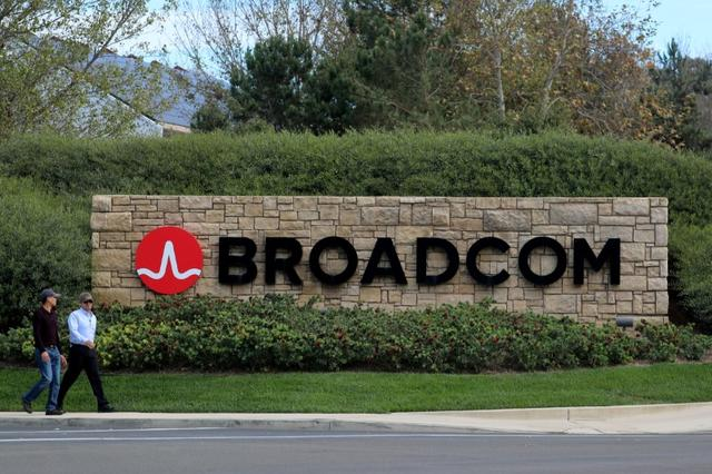 FILE PHOTO: A sign to the campus offices of chip maker Broadcom Ltd in Irvine, California, U.S., November 6, 2017.     REUTERS/Mike Blake/File Photo