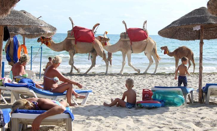 Tourists relax on a beach on the island of Djerba, Tunisia, September 7,  2016. REUTERS/Zoubeir Souissi/File Photo