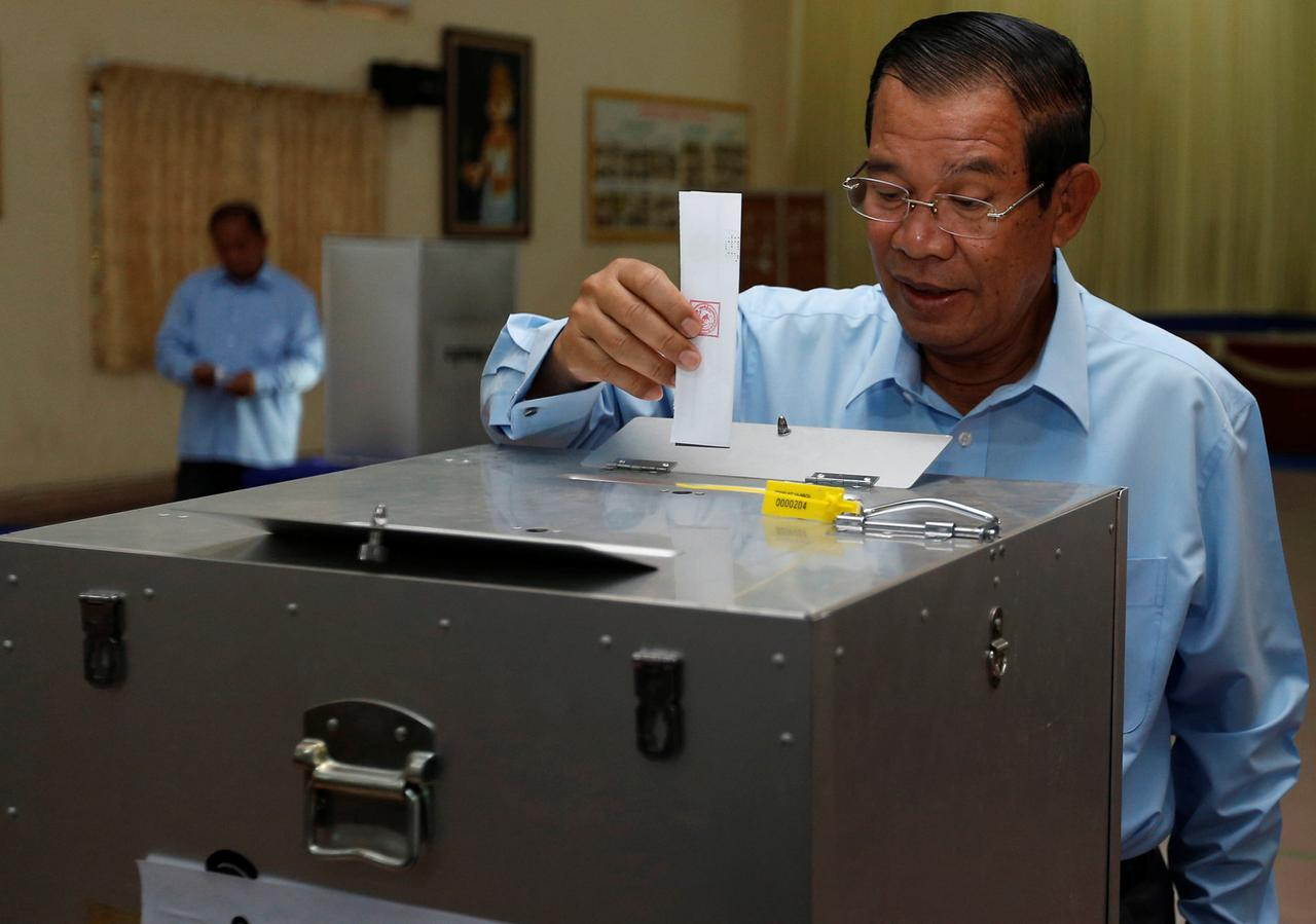Cambodia's Prime Minister and President of the Cambodian People's Party (CPP), Hun Sen drops a ballot into a box during a senate election in Takhmao, Kandal province | Reuters