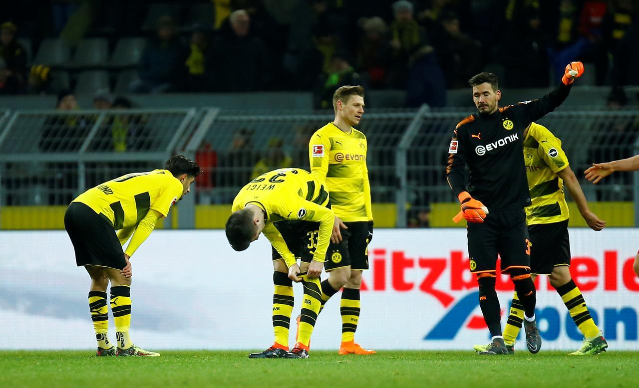 dortmund drop vital points in augsburg draw