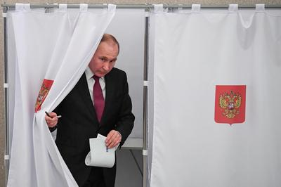 Putin wins landslide re-election in Russia