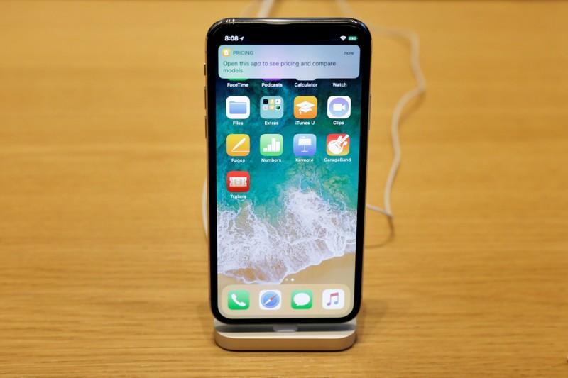 Apple supplier IQE's sales surge, but takes U S  tax hit - Reuters