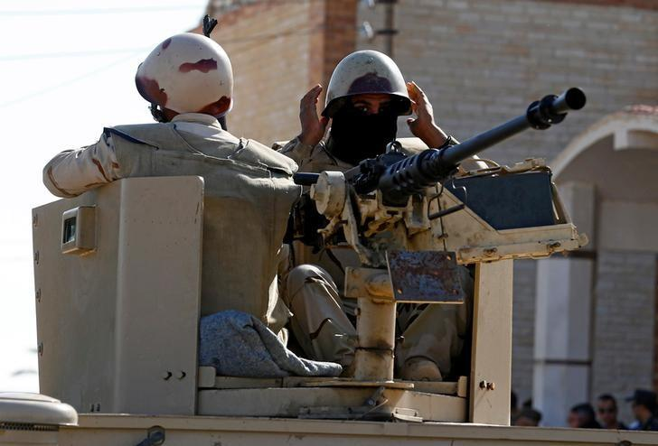 Eight Egyptian soldiers, 14 militants killed in Sinai attack
