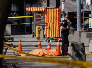 Van plows into pedestrians in Toronto