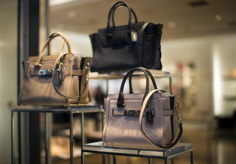 f76c710db6 Handbags are pictured through a window of a Coach store in Pasadena