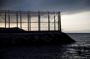 The border fence separating Spain's northern enclave Ceuta and Morocco is...