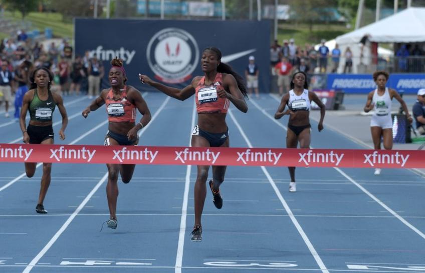 Athletics: Wimbley storms to surprising women's 400m win - Reuters
