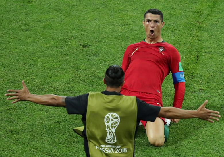 29b05ee9b Portugal s Cristiano Ronaldo celebrates scoring their second goal against  Spain. REUTERS Lucy Nicholson