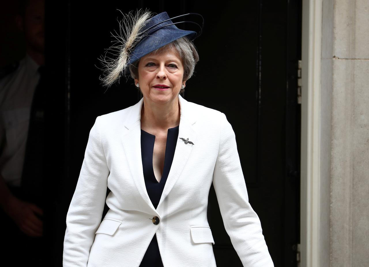 Image result for UK PM May seeks unity amid turmoil over Brexit strategy