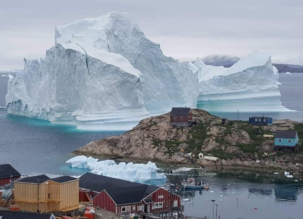 Huge iceberg drifts close to Greenland village, causing fears of a...
