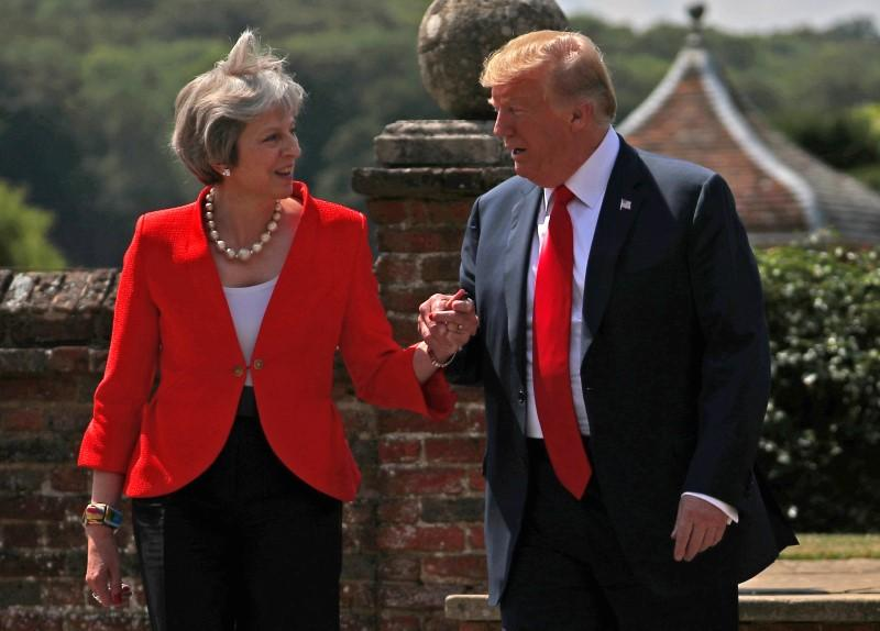 Britain's Prime Minister Theresa May and U.S. President Donald Trump walk to a joint news conference at Chequers, the official country residence of the Prime Minister, near Aylesbury, July 13, 2018. Hannah McKay