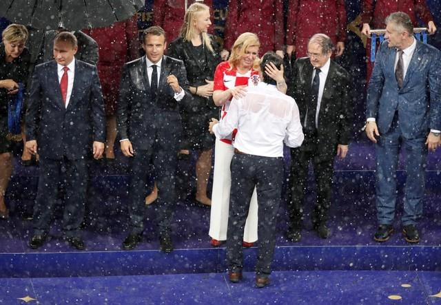 Soaked but smiling, Croatian president wins admirers at World Cup final