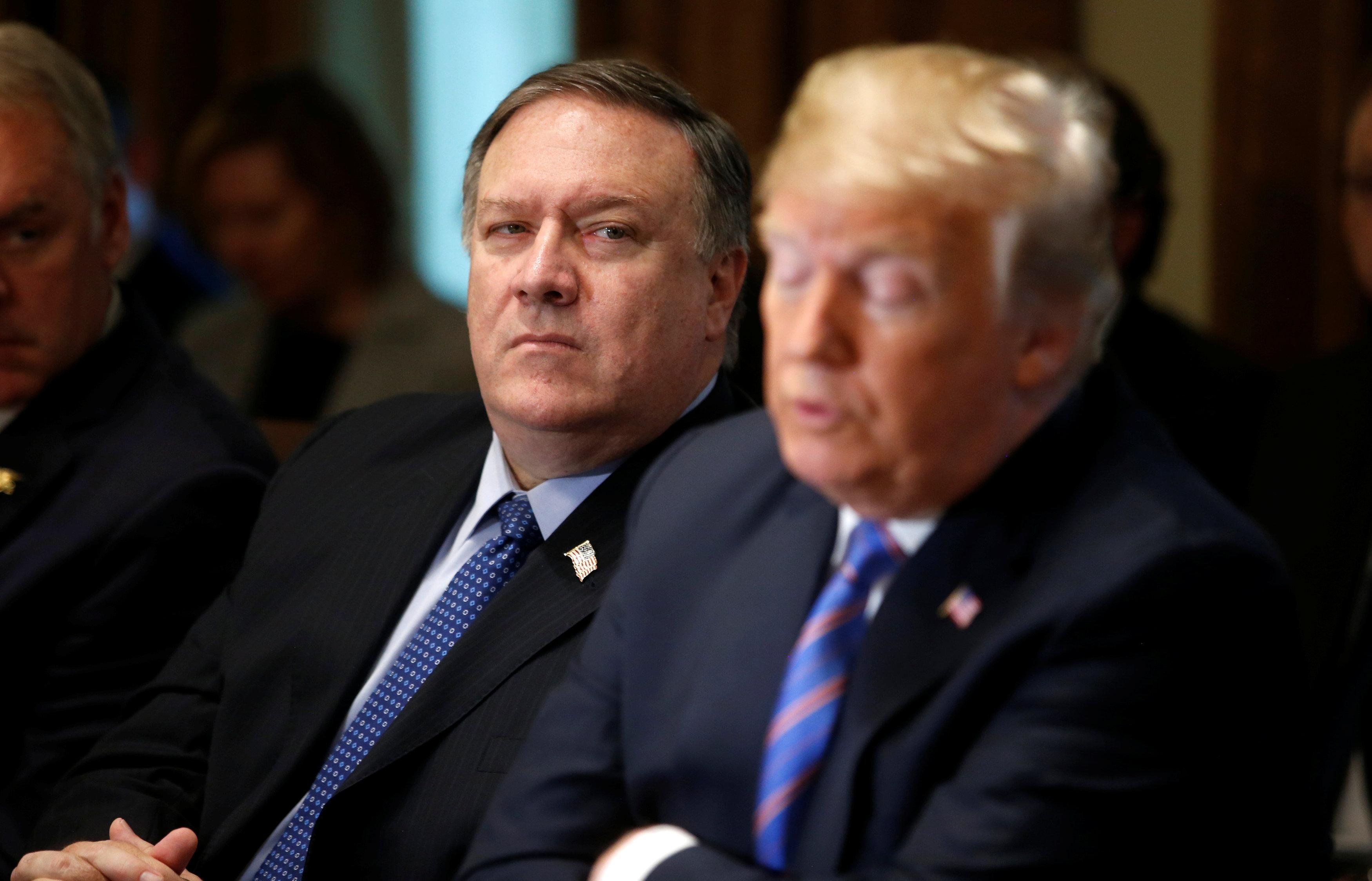 U.S. Secretary of State Mike Pompeo listens as President Donald Trump speaks during a cabinet meeting at the White House in Washington, U.S., July 18, 2018. Leah Millis