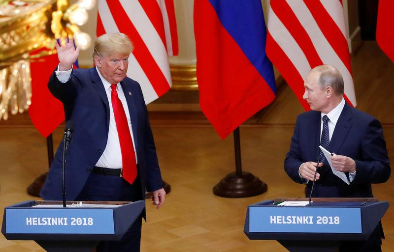 U.S. President Donald Trump and Russian President Vladimir Putin prepare to leave a joint news conference following their meeting in Helsinki, Finland, July 16, 2018. Leonhard Foeger