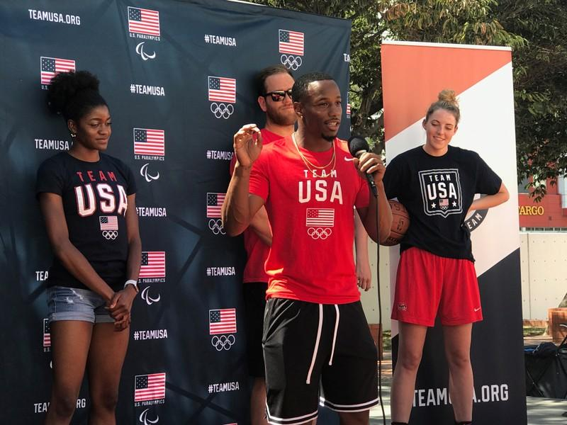 Team USA Rugby wing Carlin Isles is flanked by fellow U.S. Olympians as he speaks at an event making the two-year countdown to the Summer Games in Tokyo, in Los Angeles, California, U.S., July 24, 2018.   Rory Carroll