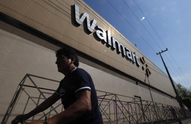 A person walks outside a Wal-Mart store in Mexico City January 11, 2013. Edgard Garrido