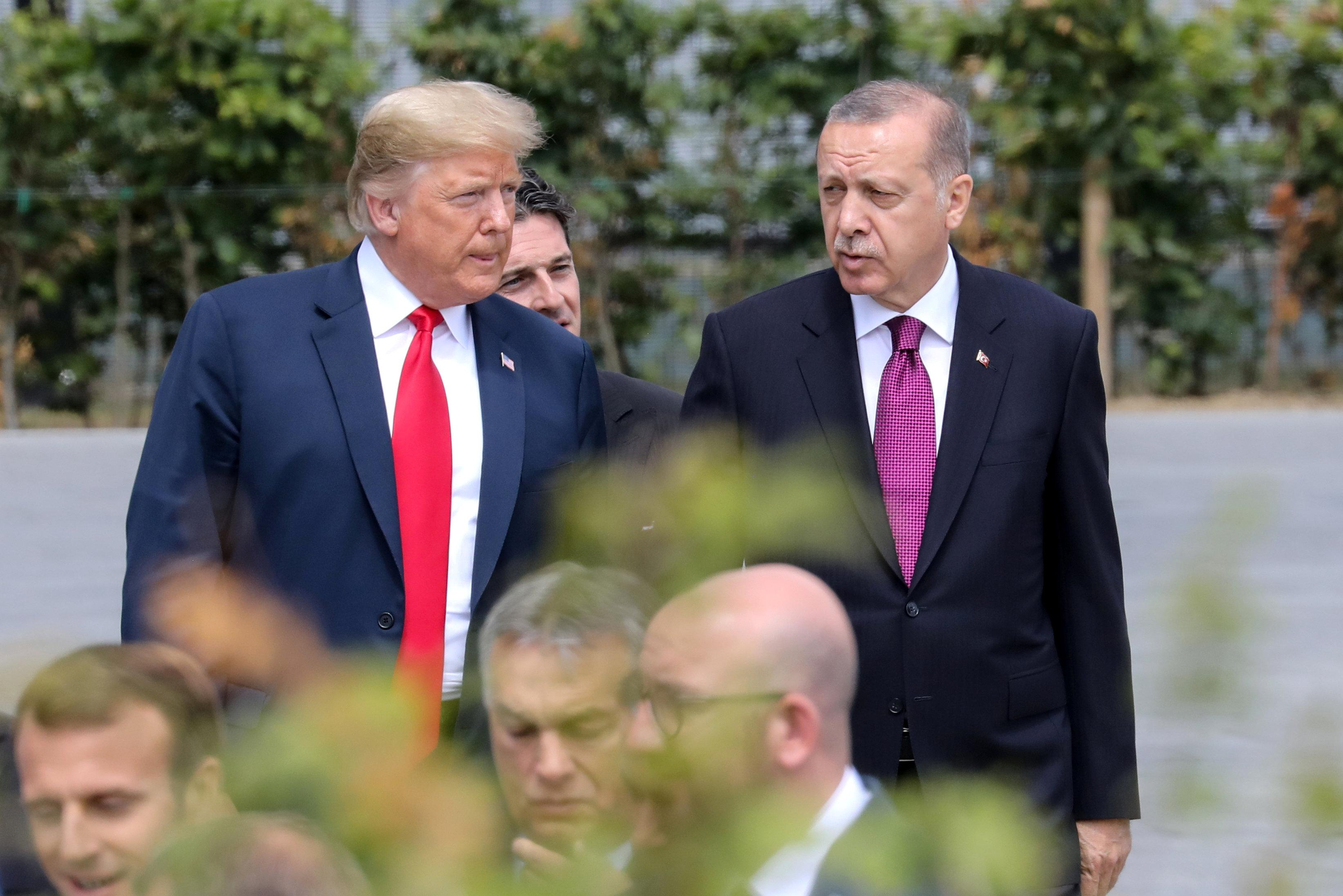U.S. President Donald Trump speaks withh Turkey's President Tayyip Erdogan ahead of the opening ceremony of the NATO (North Atlantic Treaty Organization) summit, at the NATO headquarters in Brussels, Belgium, July 11, 2018.  Ludovic Marin/Pool via