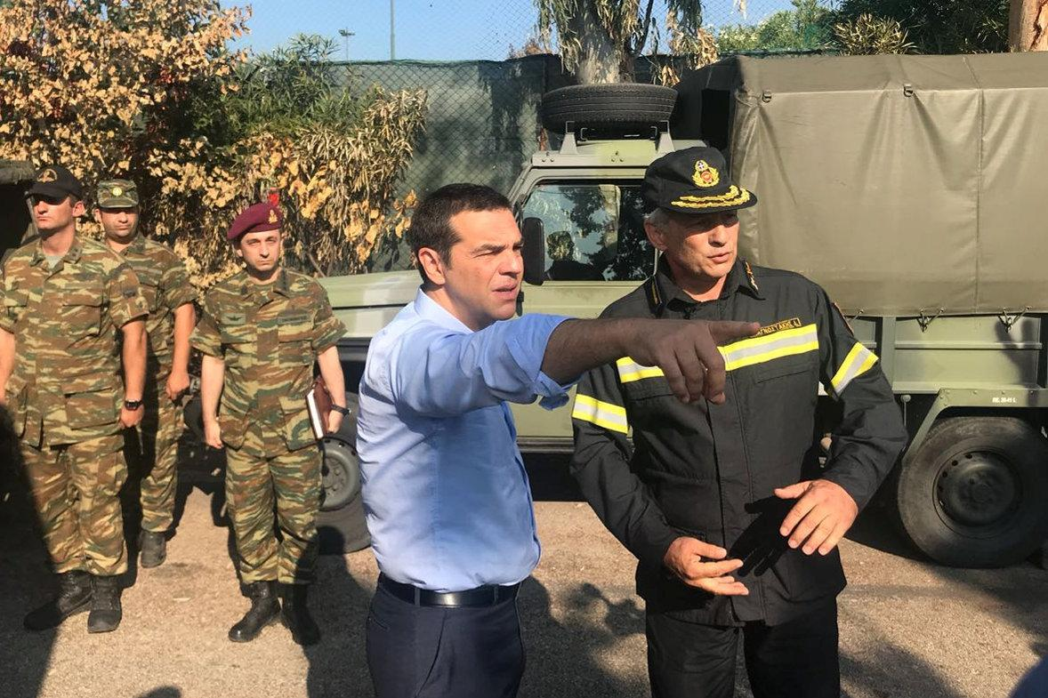 Greek PM meets survivors in fire-stricken town as families mourn dead