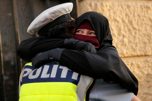 Protests after Denmark bans face veils in public