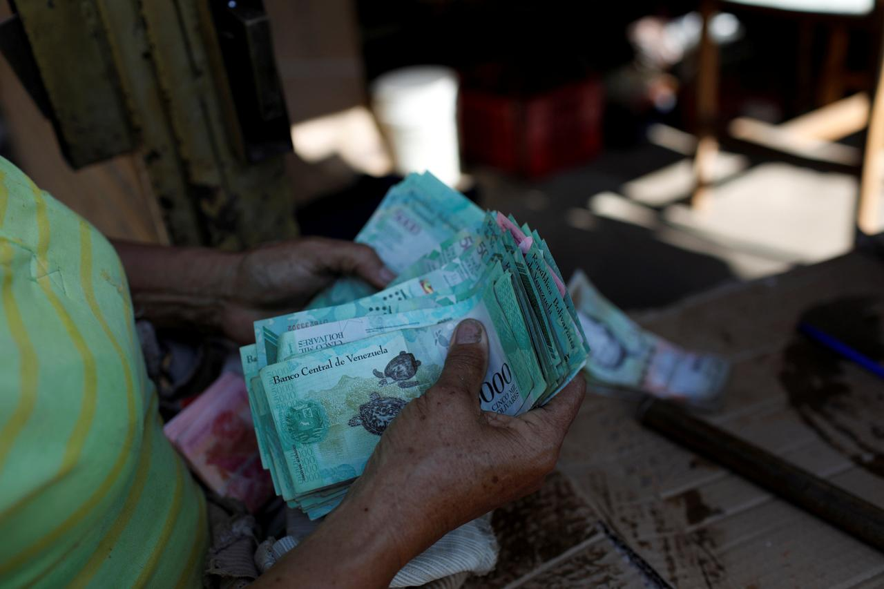 File Photo A Woman Counts Venezuelan Bolivar Notes In Her Stall At Las Pulgas Market Maracaibo Venezuela July 26 2018 Reuters Marco Bello