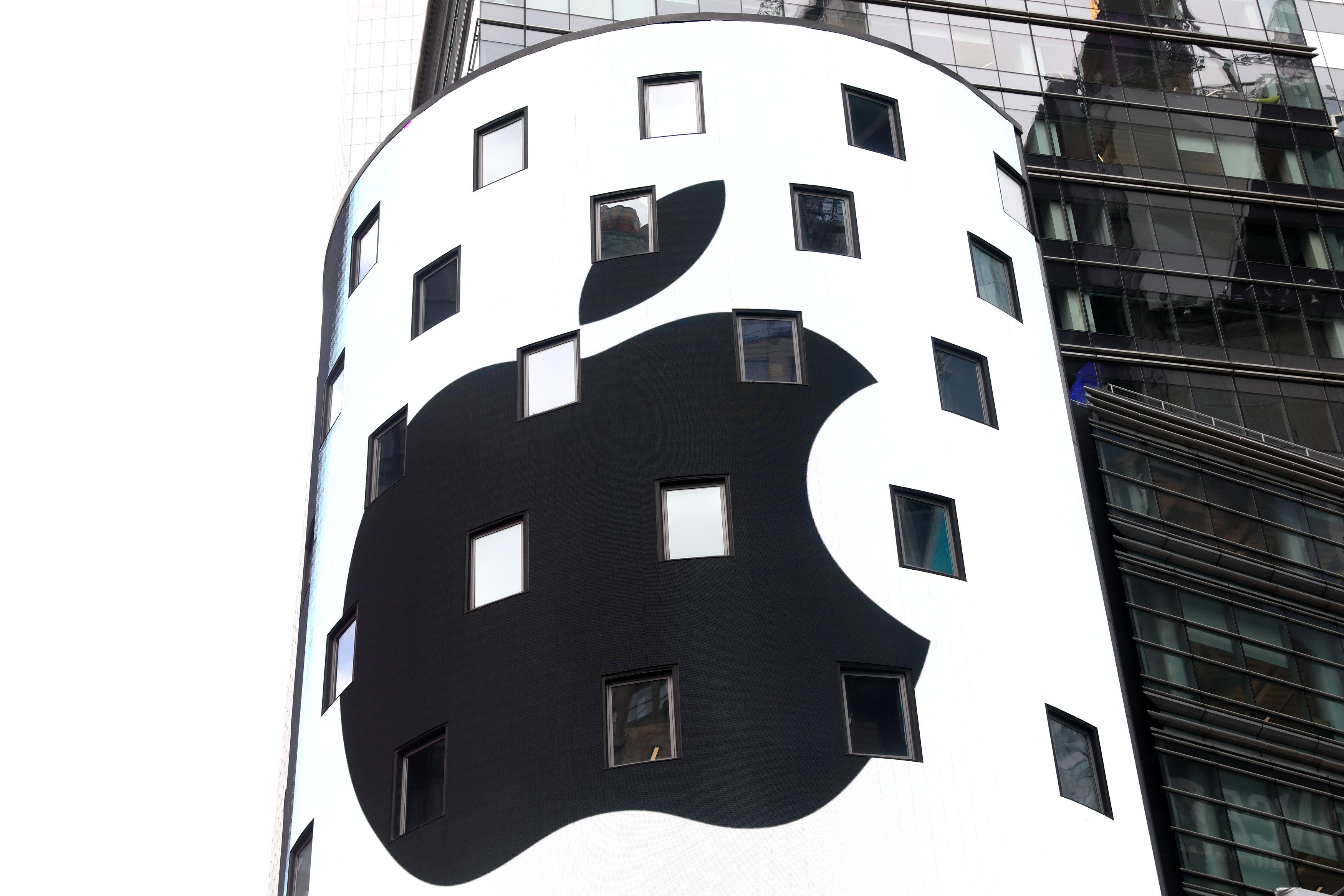 An electronic screen displays the Apple Inc. logo on the exterior of the Nasdaq Market Site following the close of the day's trading session in New York City, New York, U.S., August 2, 2018. Mike Segar