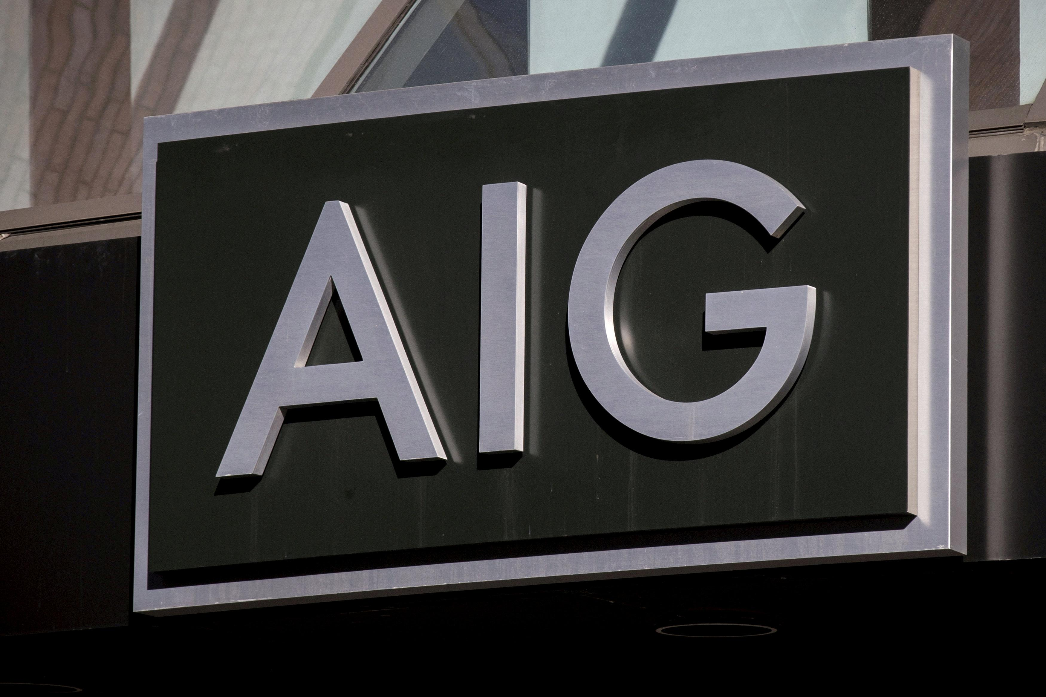 The AIG logo is seen at its building in New York's financial district in New York, NY, U.S. on March 19, 2015.   Brendan McDermid