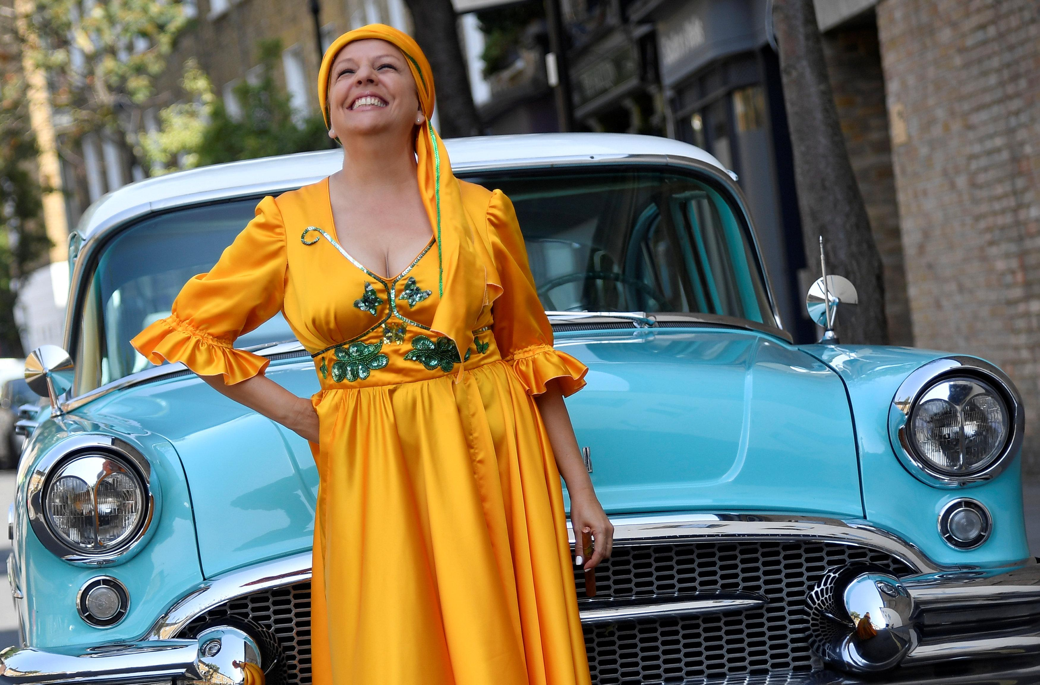 Cuban singer Albita Rodriguez stands beside a Buick Century classic car as the Grammy-award winning performer stars in the musical