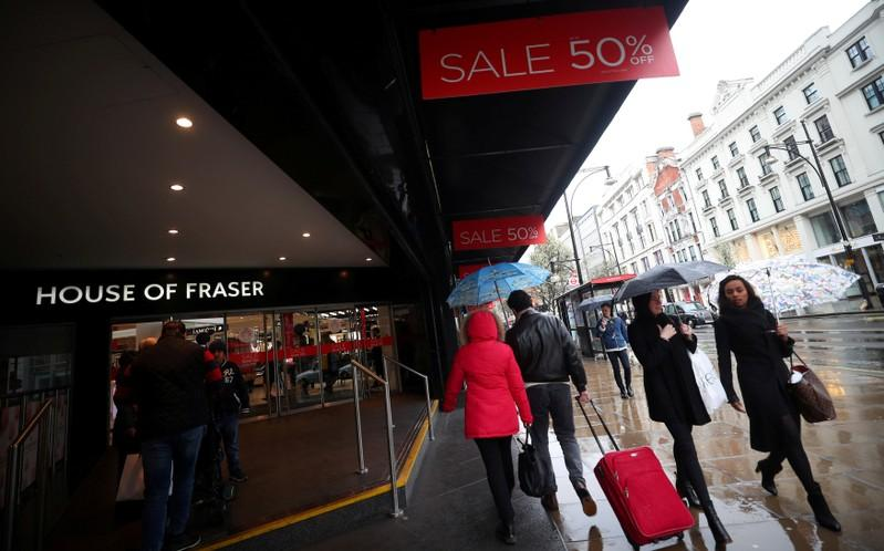 Shoppers walk past House of Fraser on Oxford Street in central London, Britain, April 2, 2018. Hannah McKay