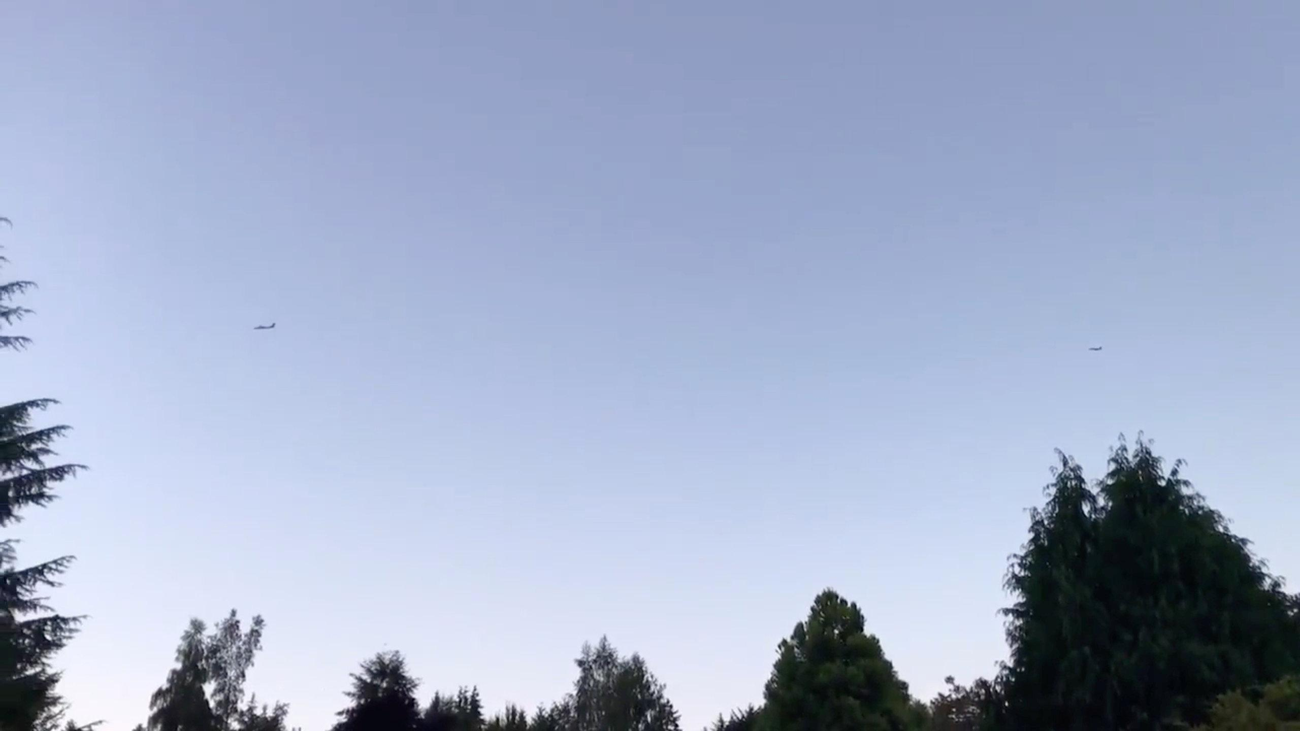An F-15 jet attempts to intercept a Horizon Air Bombardier Dash 8 Q400, which was reported to be hijacked, in Fircrest, Washington, the U.S. before crashing in south Puget Sound, August 10, 2018, in this still image taken from a video obtained from social media. Christopher Maher/via