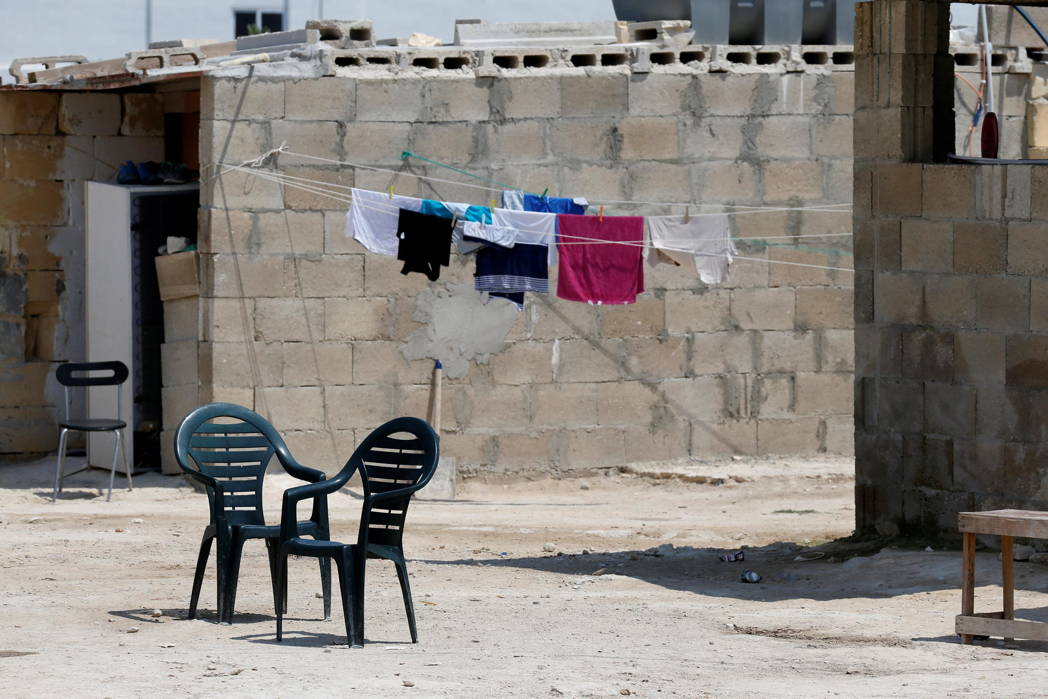 Migrants' possessions and furniture are seen on a farm where police evicted some 110 African migrants who had been living in stalls formerly used by cows, in Qormi, Malta August 13, 2018.  Darrin Zammit Lupi