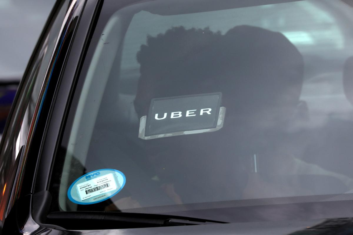 Uber narrows loss but still a long way from profitability | Reuters