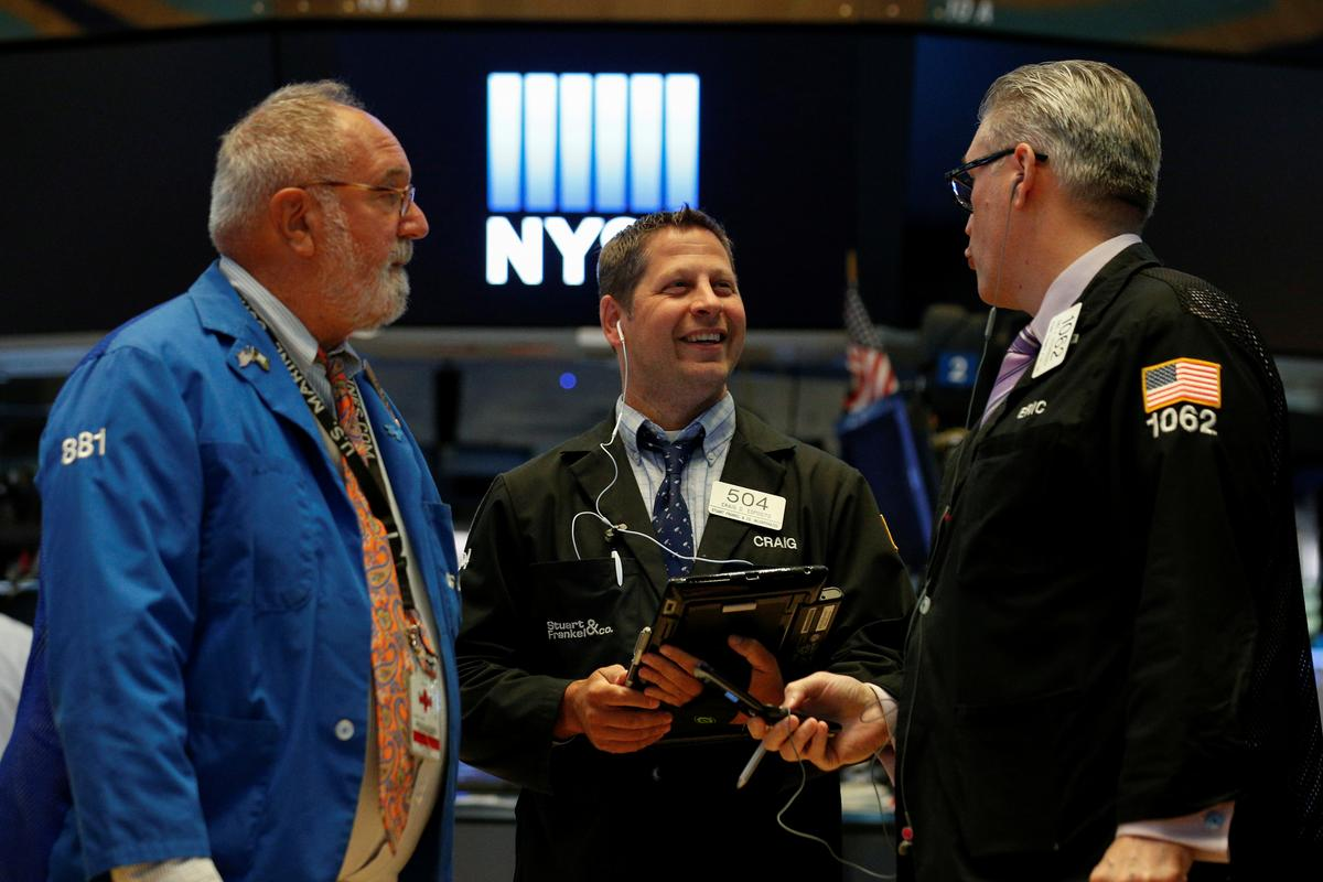 Wall St. opens higher on upbeat earnings, trade talk hopes | Reuters