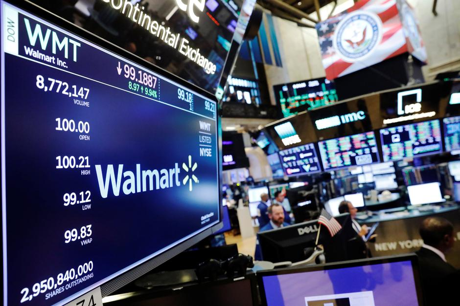 dcdf8fe9f20 A Walmart logo is displayed above the floor of the New York Stock Exchange  shortly after the opening bell in New York