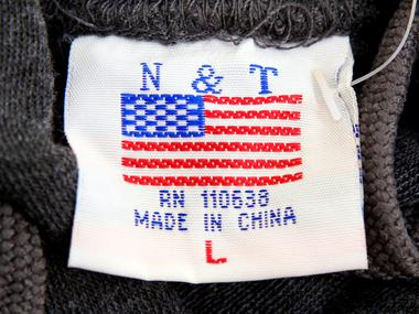 FILE PHOTO: The label of a Washington D.C. sweatshirt bears a U.S. flag but...