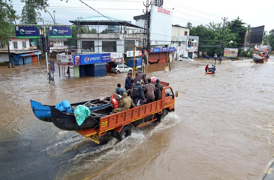 local boatmen the heroes of flood rescues in indias kerala   reuters file photo a supply truck transporting boats to flooded areas moves  through a water logged road in aluva southern state of kerala india  august
